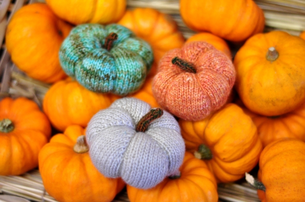Tiny knitted pumpkin in green, orange and white, knitting