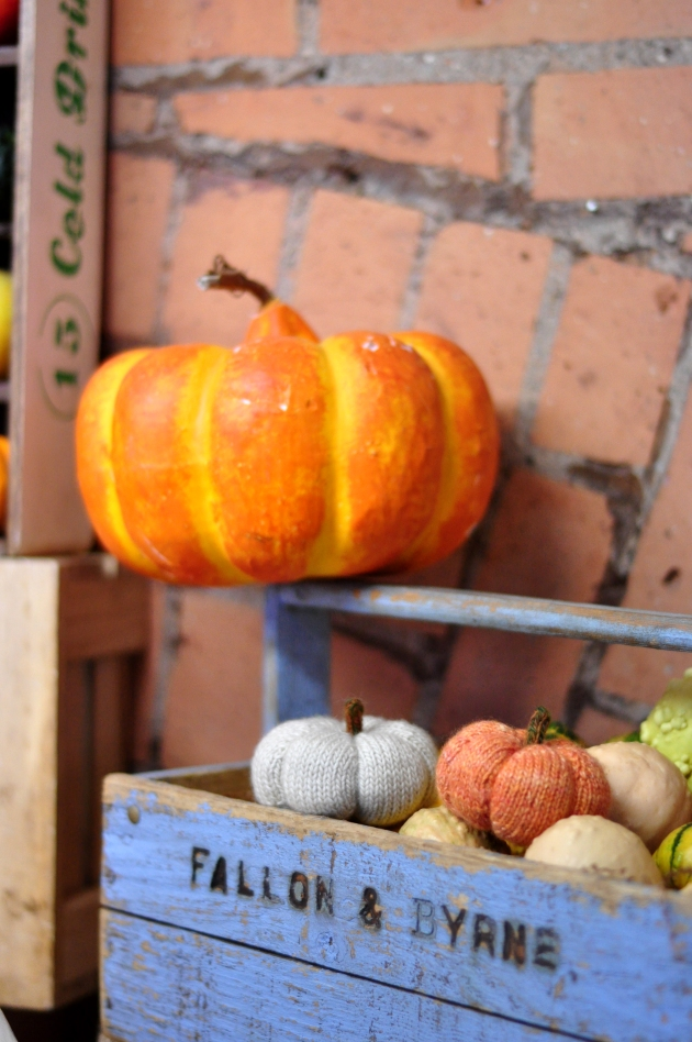 Small knitted orange and white pumpkin with other gourds #knitting